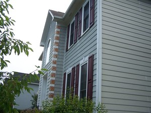 Exterior Painting being performed by an experienced R and R Painting NC LLC painter.